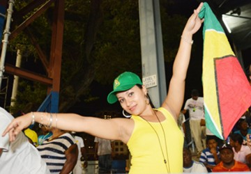 Guyana Gyal! This lovely lass is not afraid to show her support for her country and her favourite team.