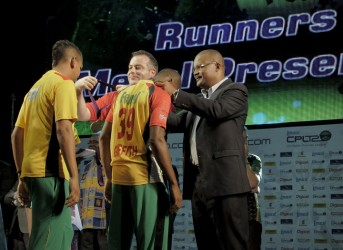 Sunil Narine and Trevon `Bugsy'  Griffith receiving their medals almost simultaneously.
