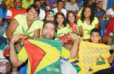 Guyanese to the bone! A patriotic Guyanese drapes the Guyana Flag across his chest.