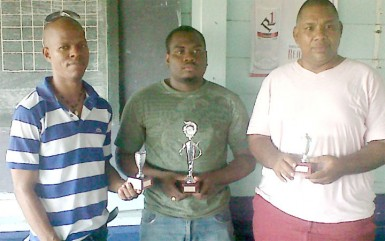 Wayne Cave along with Maurice Munro and Roberts Williams after the tournament concluded last Sunday at the Mateenoes Sports Club, Thomas Land.