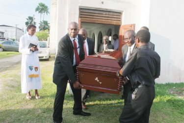 Last rites for Harold Davis: The coffin of Harold Davis being borne out of the Trinity Methodist Church on High and Leopold streets yesterday. (Arian Browne photo)