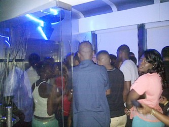 A crowd in front of the elevator serving as both entrance and exit for Gravity Lounge early Saturday morning