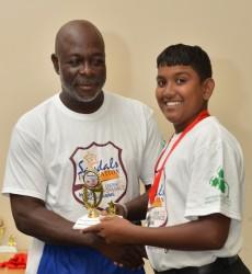 Guyana captain Bashkar Yadram receives the Most Disciplined Team award from Camp Coordinator Austin Richards Sr - WICB Media photo