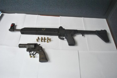 Police said both the Kel-Tec 9mm sub-machine gun with nine rounds and the .38 revolver with two rounds pictured here were recovered from the two men suspected of murdering Supply farmer Omadat Persaud. (Guyana Police Force photo)