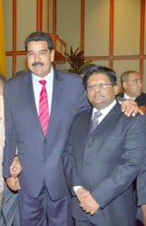 Finance Minister Dr Ashni (at left) with Venezuelan President, Nicolas Maduro during a recent meeting.