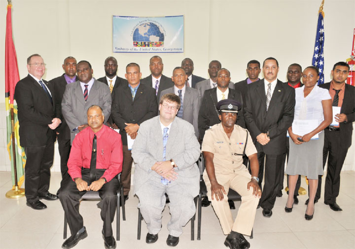 The participants in the International Passenger Identification Training Programme with (seated from left) Crime Chief Seelall Persaud, US Embassy Charge d'Affaires Bryan Hunt and Force Training Officer Paul Williams. (Photo courtesy of US Embassy Georgetown)