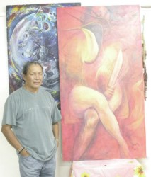 George Simon with his painting, Bimichi