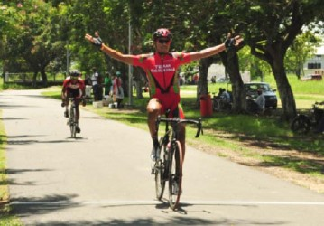 Roraima Bikers Club member Alanzo Greaves celebrates after winning yesterday's feature 35-lap event of the National Sports Commission 11-race cycle programme. (Orlando Charles photo)