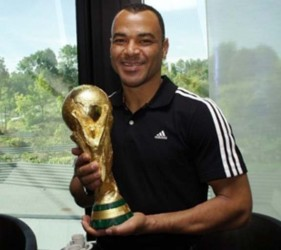 Brazilian football legend Cafu holds the FIFA World Cup Trophy during a visit to FIFA in Zurich last year. (FIFA photo)