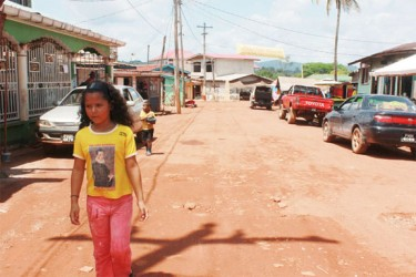 A child walks in Mahdia's Main Street.