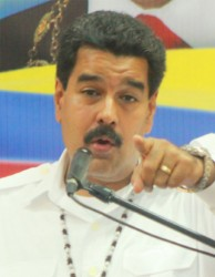 President Maduro gestures while answering a question from a reporter at the International Conference Centre yesterday. (Photo by Arian Browne)