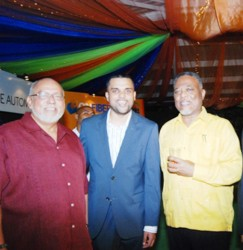 President Donald Ramotar (left) shares a moment with the Managing Director of E-Networks, Vishok Persaud (centre) and Prime Minister Samuel Hinds. (GINA photo)