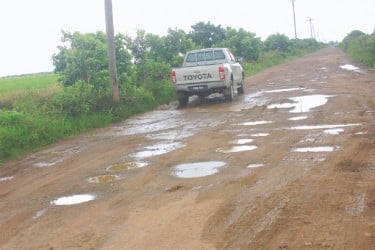 This vehicle tries to make its way out of the deplorable road