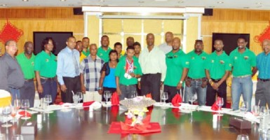 POWER MOVE! Guyana's youngest ever World Champion, Gumendra Shewdas (with medals) poses with members of his family, executive members of the Guyana Amateur Power lifting, medalists at July's Caribbean and Pan American Championships as well as Minister of Sport, Dr. Frank Anthony and Permanent Secretary of the Ministry during yesterday's luncheon at the New Thriving Restaurant. (Orlando Charles photo)