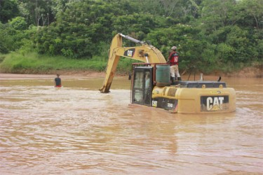An excavator crossing the Konawaruk River in Region Eight two weeks ago.