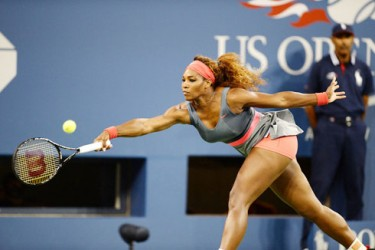 Defending US Open champion Serena Williams stretches for a forehand return during her match against Spain's Carla Suarez Navarro which she easily won 6-0 6-0.