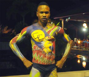 Jamain Victor in body paint of the Caricom and Carifesta logos at a fashion show