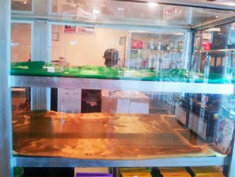 An empty display case after the robbery at Issacs Computer Electronics on the third floor of the Regent Multiplex mall on Regent and Wellington streets yesterday.