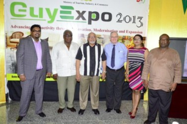 Launch of GuyExpo 2013 - Minister of Tourism Industry and Commerce (ag) Irfaan Ali, President of the Guyana Manufacturing and Services Association Clinton Williams, President Donald Ramotar, Chairman of the Private Sector Commission Ron Webster, Event coordinator Tameca Sukhdeo-Singh, CEO, Small Business Bureau Derrick Cummings. Photo courtesy of GINA