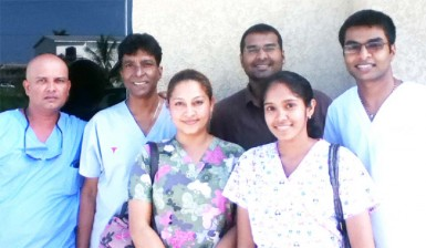 From left: Dental Technician Seeram Mohammed, Dentists  Dr Clive Jagan, Dr Shane Jagan, Dr Ian Jagan In front: Dental Assistant Ramona Subryan and Devi Louknauth, Inset:  Dr Kyle Jagan