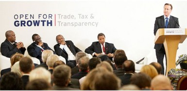 UK Prime Minister David Cameron leading a discussion at an Extracted Industries Transparency inititative (EITI) during the 2013 G8 Summit in Northern Ireland. From left: President Mahama from Ghana, President Sall from Senegal, President Conde from Guinea, President Kikwete from Tanazania, and UK PM Cameron. Photo courtesy of the G8 UK Presidency