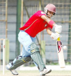 Robin Bacchus drives in his innings of 85