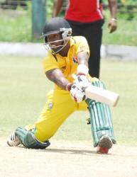 Shemroy Barrington sweeps in his innings of 88