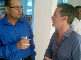 Natural Resources Minister Robert Persaud (left) and HFD investor Jarel Dawson during yesterday's opening ceremony