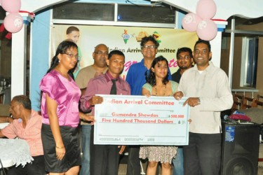 Members of the Indian Arrival Committee (IAC) presented Guyana's youngest ever world champion, power lifter Gumendra Shewdas with a $500,000 cheque Saturday night in honour of his historic achievement at the World Sub Juniors and Juniors Championships in Killeen, Texas. (Orlando Charles photo)