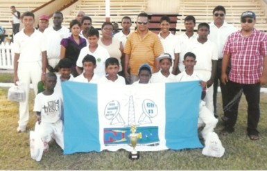 The winning U15 team posing with NCN members and members of the Berbice Cricket Board.