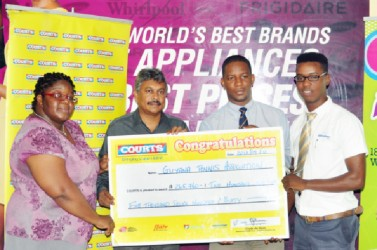 GLTA Vice President Grace McCalman (left) and GLTA President Ramesh Seebarran (second left) collect the sponsorship cheque from Courts Marketing Manager Pernell Cummings (right) and Courts Public Relations Officer (PRO) Kester Abrams.