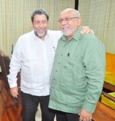 President Donald Ramotar (right) with St Vincent Prime Minister Ralph Gonsalves at the Office of the President on Monday. (GINA photo)