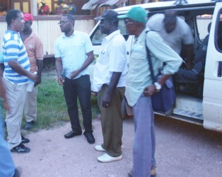 (Left to right) Charles Thom meets Leslie Gonsalves (partially hidden), Regional Chairman Sharma Solomon, Maurice Butters and Stanley Collins on their arrival at the Kwakwani Workers Club last Friday.