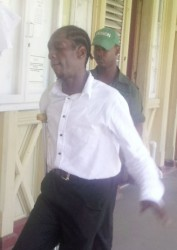 Murder accused Stravo Evans being led to the court yesterday