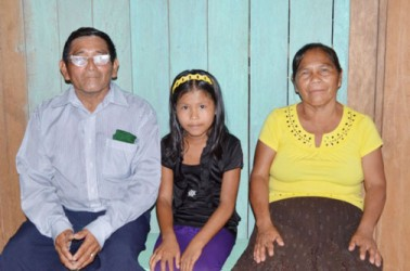 Beneficiaries, Verly Fredricks and her husband Rileigh Fredricks, and their daughter in their new home (GINA photo)