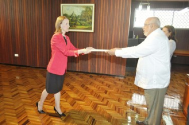 New Canadian High Commissioner to Guyana, Dr. Nicole Giles presenting her Letters of Credence to President Donald Ramotar at the Office of the President yesterday. Dr Giles is the first female Canadian High Commissioner to Guyana. (GINA photo)