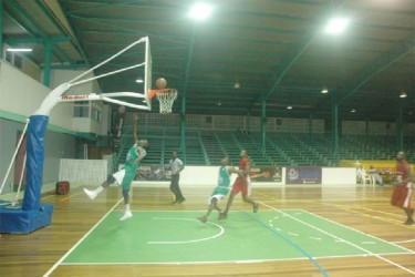 Lodge-Meadowbrook's Shawn Blair (in green) scoring an easy basket against Buxton in their group 'C' fixture.