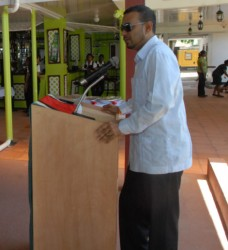 Natural Resources and Environment Minister Robert Persaud  addressing delegates to the hemispheric forestry forum.