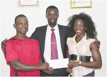 Public Relations Manager of Giftland OfficeMax, Compton Babb (centre) poses with Devon Davis and Alisha Fortune following the company's sponsorship commitment.