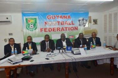 FIFA's Development Officer, Howard McIntosh makes a point during yesterday's press briefing at the GFF head office as executive members of the federation look on.