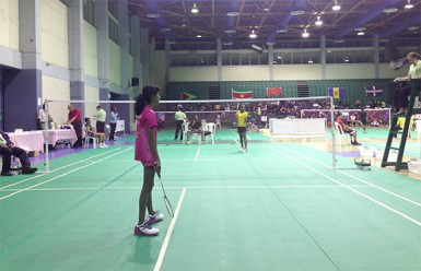 Priyanna Ramdhani competing in her U13 finals match with Jamaican Shezelle McTyson.