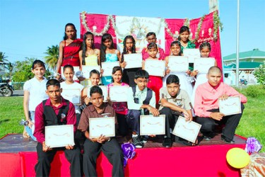 Students who graduated from the Aditya Foundation with their certificates