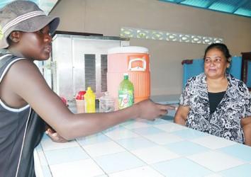 Bibi Mohamed tending to a customer