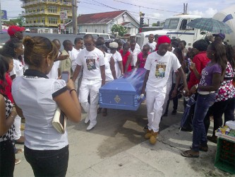 Pall bearers carry the body of murdered biker Kirk Davis yesterday