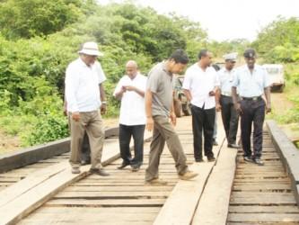 Prime Minister Sam  Hinds (left) examines the newly rehabilitated Moco Moco bridge (GINA photo)