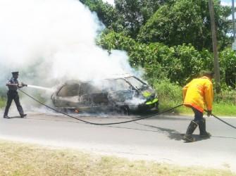 Firemen putting out the blaze (Juanita Hooper photo)
