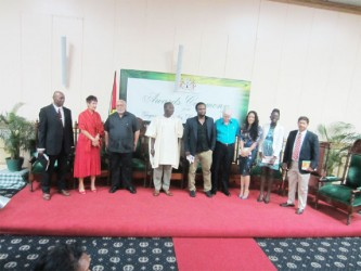Guyana Prize: President Donald Ramotar (third from left) with from left Al Creighton,  Secretary of the  Management Committee of the Guyana Prize for Literature; Chairman of the Jury, Professor Jane Bryce; UG Vice-Chancellor Jacob Opadeyi; Ruel Johnson; Dr Ian McDonald; Cassia Alphonso; Mosa Mathifa Telford and Chaitaram Singh.