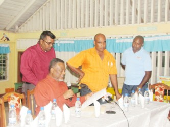 Prime Minister Samuel Hinds reads details of the purchase of the new generators for Lethem (GINA photo)
