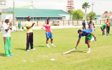 Chairman of the national selection panel Rayon Griffth applauds the effort of Paul Wintz at yesterday's Demarara Inter-County cricket squad fitness drills. (Orlando Charles photo)