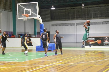 A Tucville/Guyhoc player attempting a shot against East/West Ruimveldt side Sunday night at the Cliff Anderson Sports Hall in the Inter-Ward encounter.